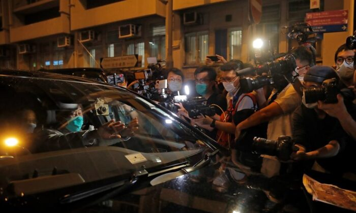 Hong Kong media tycoon and newspaper founder Jimmy Lai, sits in a car as he leaves a police station after being bailed out in Hong Kong on Aug. 12, 2020. The rounding up of the paper's founder Jimmy Lai, the previous day and a raid on its headquarters have reinforced fears that a new national security law will be used to suppress dissent in Hong Kong after months of anti-government protests. (AP Photo/Kin Cheung)