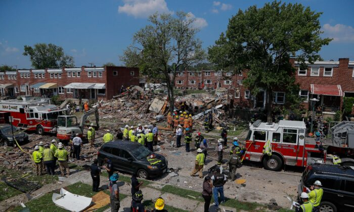 The aftermath of an explosion in Baltimore on Monday, Aug. 10, 2020. (AP Photo/Julio Cortez)