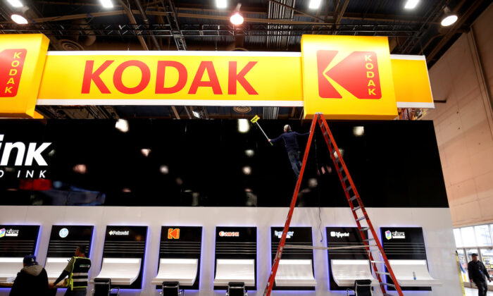 A worker cleans a Kodak booth at the Las Vegas Convention Center in preparation for 2019 CES in Las Vegas, Nevada, on Jan. 6, 2019. (Steve Marcus/File Photo/Reuters)