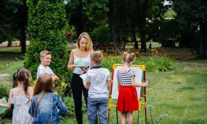 In learning pods, or microschools, small groups of families take turns teaching children, or pool resources to hire a teacher. (Andrii Medvednikov/Shutterstock)