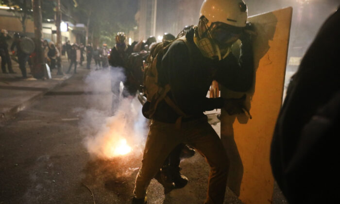 Protesters clash with federal police in front of the Mark O. Hatfield federal courthouse in downtown Portland, Ore., as the city experiences another night of unrest on July 28, 2020. (Spencer Platt/Getty Images)