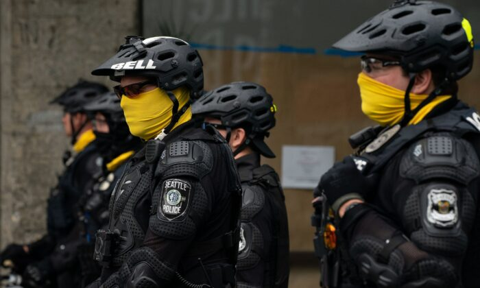 Police officers block a street outside of the Seattle Police Department's East Precinct, in Seattle on July 1, 2020. (David Ryder/Getty Images)