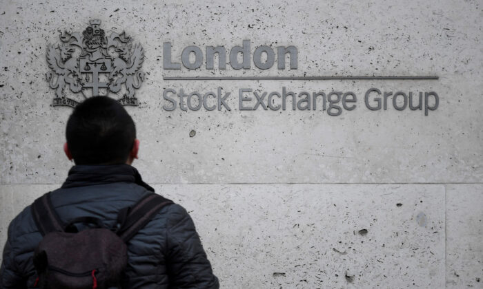 A pedestrian in front of the London Stock Exchange offices in the City of London on Dec. 29, 2017. (Toby Melville/File Photo/Reuters)