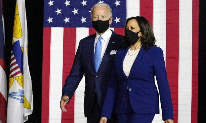 Democratic presidential candidate Joe Biden and his running mate Sen. Kamala Harris (D-Calif.) arrive to speak at a news conference at Alexis Dupont High School in Wilmington, Del., on Aug. 12, 2020. (Carolyn Kaster/AP Photo)