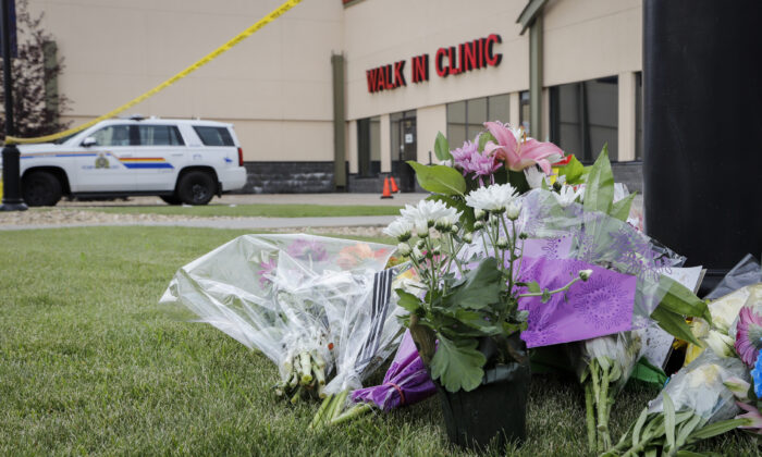 An impromptu memorial for Dr. Walter Reynolds, who died after he was attacked in an examination room rests outside the Village Mall walk-in clinic in Red Deer, Alta., Aug. 11, 2020. (THE CANADIAN PRESS/Jeff McIntosh)