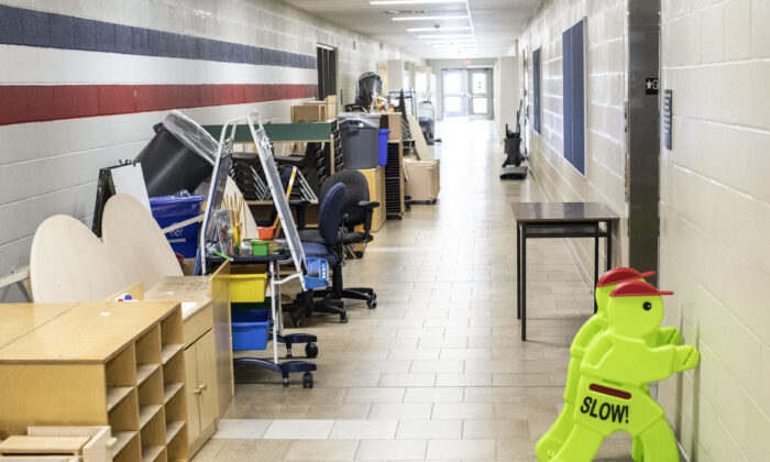 Furniture stands in a corridor at a school in Brampton, Ont. on July 23, 2020. Plans are being made across the country for how to safely send students back to school in the fall as the COVID-19 pandemic continues. (Chris Young/The Canadian Press)
