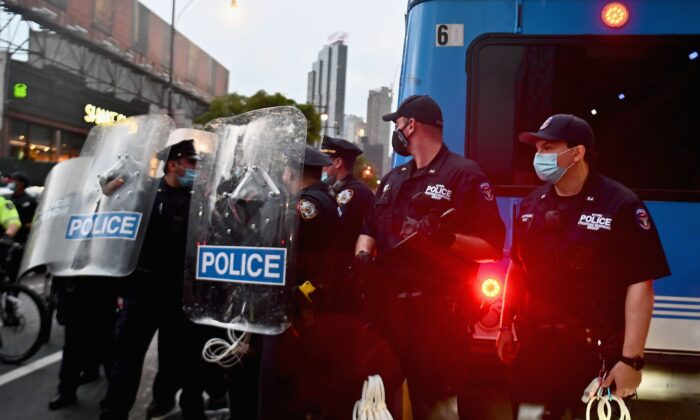 """NYPD officers stand guard during a """"Black Lives Matter"""" protest near Barclays Center in the Brooklyn borough of New York City on May 29, 2020. (Angela Weiss/AFP via Getty Images)"""