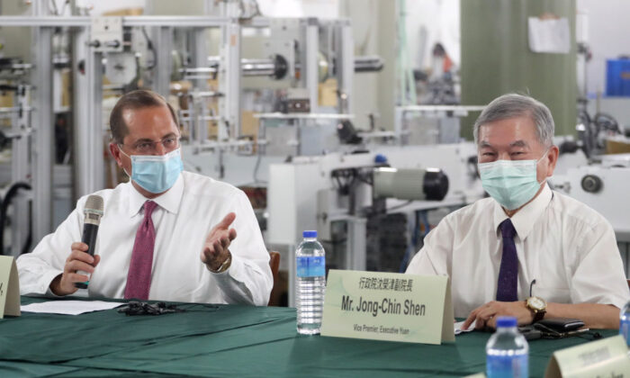 US Secretary of Health and Human Services Alex Azar (L) speaks as Taiwan's Deputy Premier Shen Jong-chin (R) listens during a visit of a mask factory in the Wugu District in New Taipei City on Aug. 12, 2020. (Pei Chen/POOL/AFP via Getty Images)