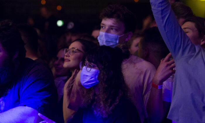Music fans wear PPE at Castaway Unlocked at HBF Stadium in Perth, Australia on July 18, 2020. (Matt Jelonek/Getty Images)