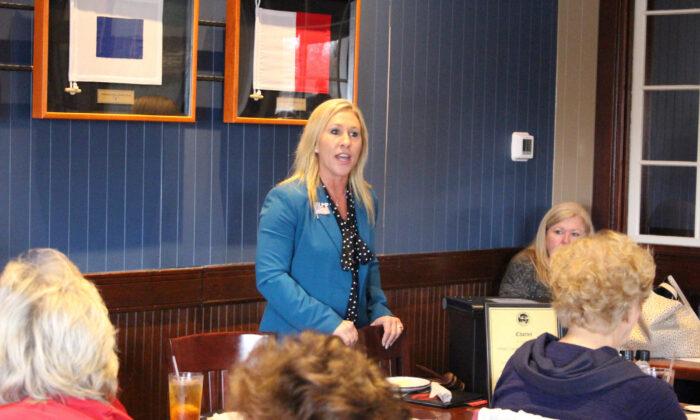 Then-Republican congressional candidate Marjorie Taylor Greene speaks to a GOP women's group in Rome, Ga., on March 3, 2020. (John Bailey/Rome News-Tribune via AP)