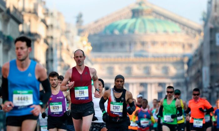 Runners compete past Paris Opera during the 43nd edition of the Paris Marathon in Paris, on April 14, 2019. (Kenzo Tribouillard/AFP via Getty Images)