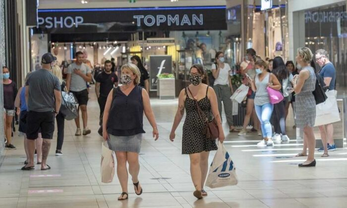 Shoppers walk through Carrefour Laval shopping centre as malls across Quebec reopened amid the COVID-19 pandemic, in Laval, Que., on June 19, 2020. (Ryan Remiorz/The Canadian Press)