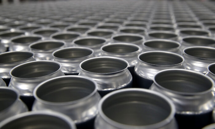 Stacks of empty aluminum cans sit on a pallet before being filled with beer at Devil's Canyon Brewery in San Carlos, California in a file photo. New tariffs imposed by the United States on aluminum from Canada could cause the price of canned beer and soft drinks to rise. Canada is taking decisive action to counter the 10 percent tariff. (Justin Sullivan/Getty Images)