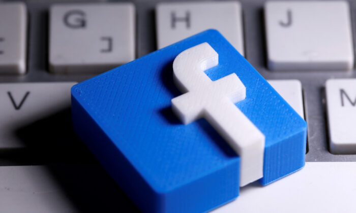 A 3D-printed Facebook logo is seen placed on a keyboard in this illustration taken March 25, 2020. (Dado Ruvic/Illustration/Reuters)