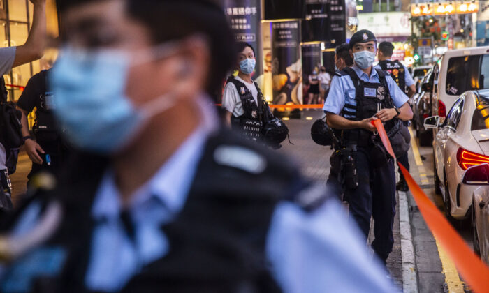 Police set up a cordon outside after people were protesting for press freedom inside a mall in Hong Kong on Aug. 11, 2020. (Isaac Lawrence/AFP via Getty Images)