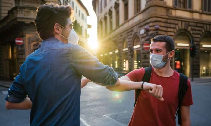COVID-19 may prevent old habits of social connection, but we can find new ways to affirm our regard for each other with a little effort. (loreanto/Shutterstock)