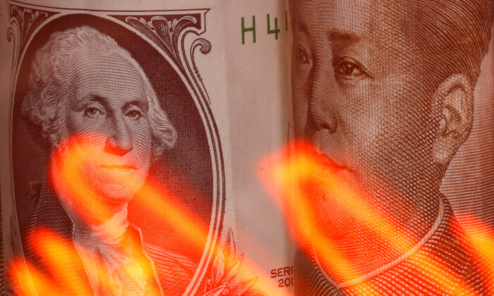 Chinese Yuan and U.S. dollar banknotes are seen behind an illuminated stock graph in this illustration taken Feb. 10, 2020. (Dado Ruvic/Illustration/ Reuters)
