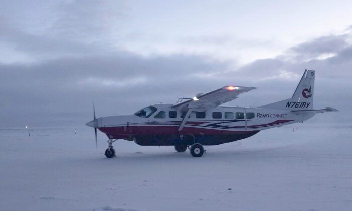 A Ravn Connect airplane lands at the airstrip in Toksook Bay, Alaska, on Jan 22, 2020. (Mark Thiessen/AP Photo)