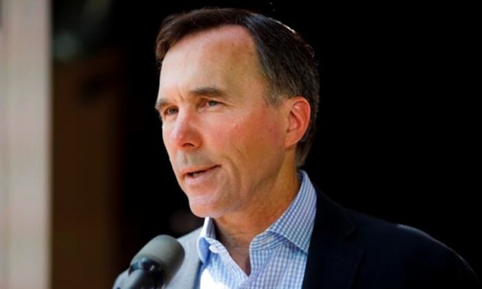 Canada's official fiscal watchdog says the federal wage subsidy program may cost more than $14 billion less than what the government estimated. Canada's Minister of Finance Bill Morneau speaks to media during a press conference in Toronto on July 17, 2020. (The Canadian Press/Cole Burston)