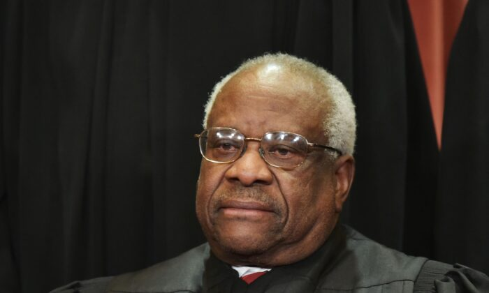 Associate Justice Clarence Thomas poses for the official group photo at the Supreme Court in Washington on Nov. 30, 2018. (Mandel Ngan/AFP via Getty Images)