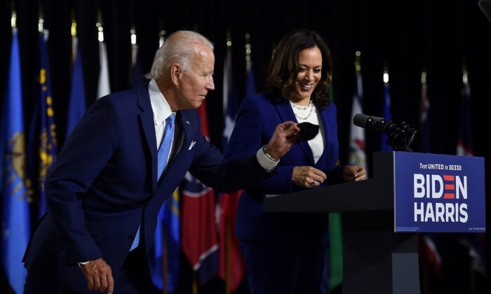 Democratic presidential nominee and former Vice President Joe Biden grabs his mask after introducing his vice presidential running mate, Sen. Kamala Harris, during their first press conference together in Wilmington, Del., on Aug. 12, 2020. (Olivier Douliery/AFP via Getty Images)