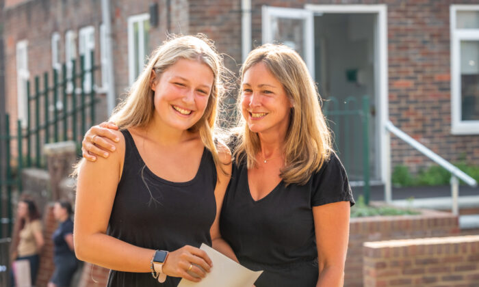 Olivia Welsh and her mother Alex react after receiving A-Level results at Lewes Old Grammar School in Lewes, United Kingdom, on Aug. 13, 2020. (Andrew Hasson/Getty Images)
