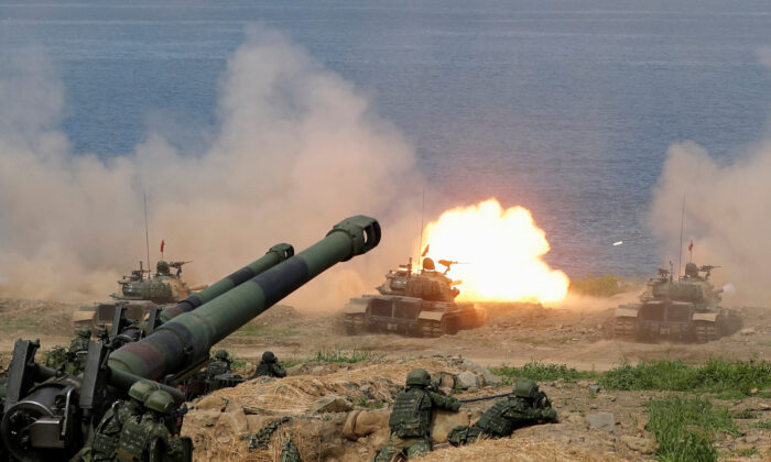 A CM-11 Brave Tiger tank fires during the live fire Han Kuang military exercise, which simulates China's People's Liberation Army (PLA) invading the island, in Pingtung, Taiwan, on May 30, 2019. (Tyrone Siu/Reuters)