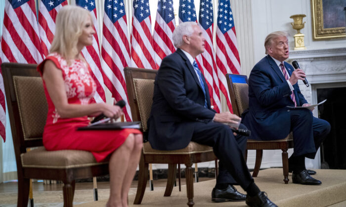"President Donald Trump with Vice President Mike Pence and Kellyanne Conway as they participate in ""Kids First: Getting America's Children Safely Back to School"" event at the White House, on Aug. 12,  2020. (Doug Mills/The New York Times via Getty Images)"