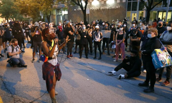 Ariel Atkins, a lead organizer for Black Lives Matter Chicago, leads a protest outside the Chicago Police Department's District 1 station in Chicago, Aug. 10, 2020. (Charles Rex Arbogast/AP Photo)