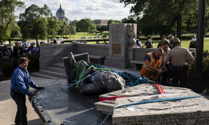 A statue of Christopher Columbus, which was toppled to the ground by vandals, is loaded onto a truck on the grounds of the State Capitol in St Paul, Minn., on June 10, 2020. (Stephen Maturen/Getty Images)