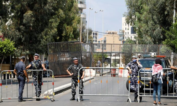 Members of Lebanese security forces block a road to stop protesters from reaching the UNESCO Palace where Lebanon's parliament is holding a session, in the aftermath of a massive explosion in Beirut's port area, in Beirut, Lebanon, on Aug. 13, 2020. (Thaier Al-Sudani/Reuters)