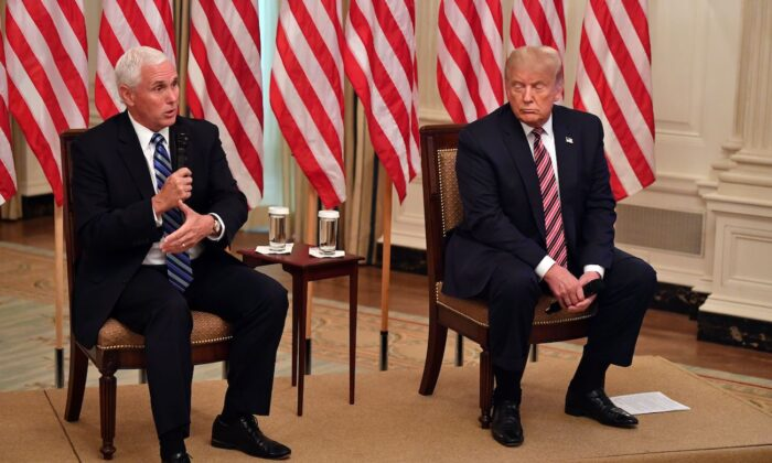 """Vice President Mike Pence and President Donald Trump attend the """"Getting America's Children Safely Back to School"""" event in the State Room of the White House in Washington, on Aug. 12, 2020. (Nicholas Kamm/AFP via Getty Images)"""