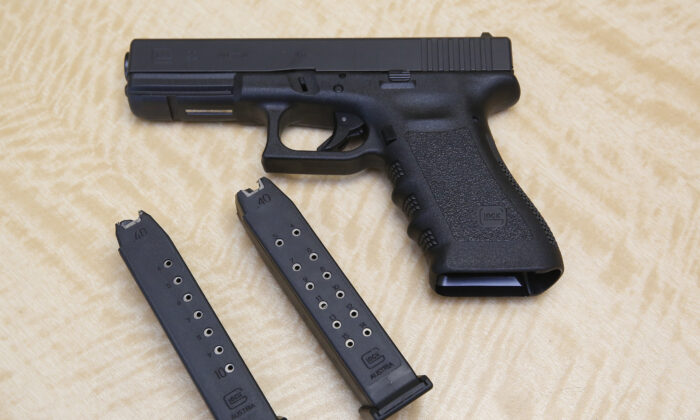 A semi-automatic hand gun is displayed with a 10 shot magazine (L) and a 15 shot magazine at a gun store in Elk Grove, Calif., on June 27, 2017. (Rich Pedroncelli/AP Photo)
