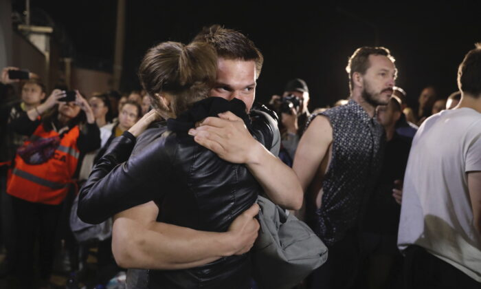 A couple hugs after being released from a detention center where protesters were detained during a mass rally following presidential election in Minsk, Belarus, on Aug. 14, 2020. (AP Photo)