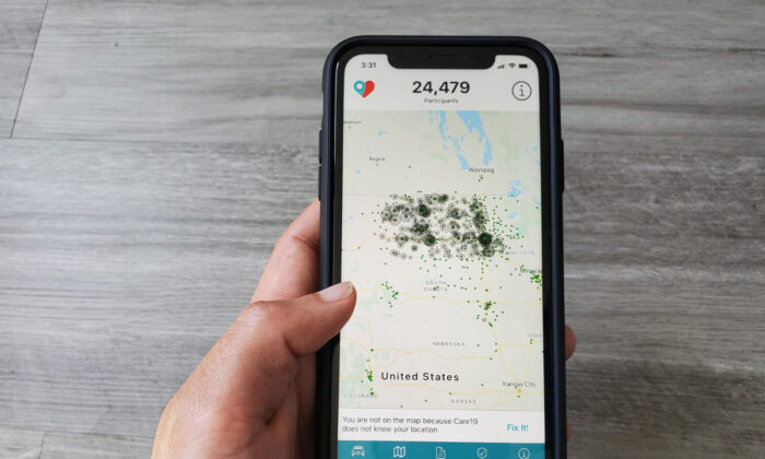 The Care19 mobile app, which the governors of North Dakota and South Dakota have asked residents to download to assist in contact tracing during the global outbreak of the COVID-19, is seen on a phone, on April 24, 2020. (Paresh Dave/Reuters)