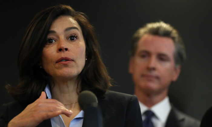 California Department of Public Health Director and State Health Officer Dr. Sonia Angell (L) speaks as California Gov. Gavin Newsom (R) looks on during a news conference at the California Department of Public Health in Sacramento, Calif., on Feb. 27, 2020. (Justin Sullivan/Getty Images)