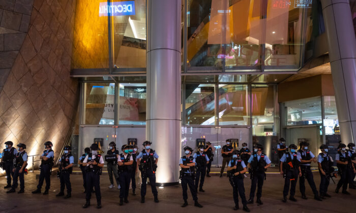 Police stand guard at a mall in Hong Kong after people held a protest for press freedom on Aug. 11, 2020. (Billy H.C. Kwok/Getty Images)