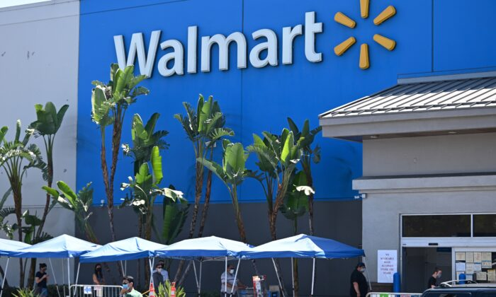 People wearing face coverings wait in line to shop at Walmart in Burbank, Calif., on July 22, 2020. (Robyn Beck/AFP via Getty Images)