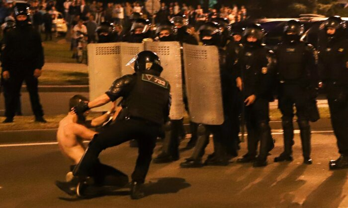A police officer detains a protester after the presidential election in Minsk, Belarus, on Aug. 10, 2020. (AP Photo)