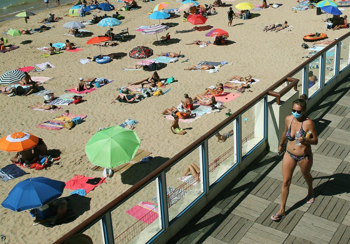 Woman walks near the beach, in Saint Jean de Luz, southwestern France