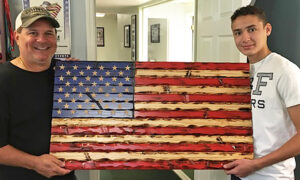 Teen Carves Wooden Flags to Raise Money for Forgotten Veterans and Medical Heroes