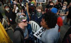 Police Arrive in Force to Disperse Rally for Georgia Confederate Monument