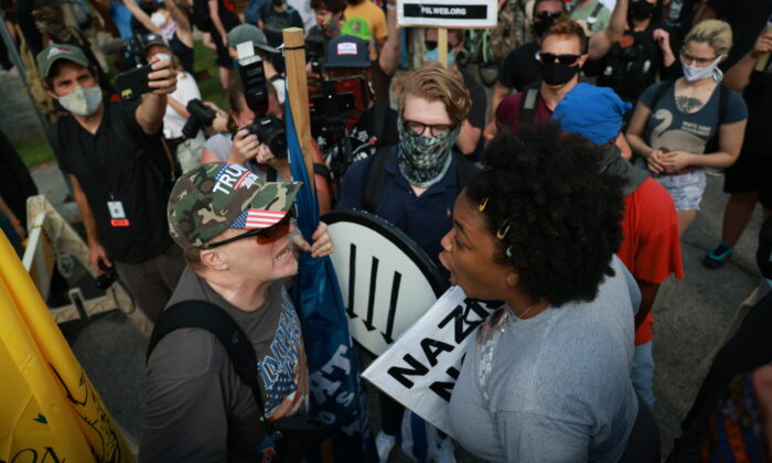 A woman argues with a protester during a rally in support of Confederate monuments in Stone Mountain, Ga., on Aug. 15, 2020. (Lynsey Weatherspoon/Getty Images)