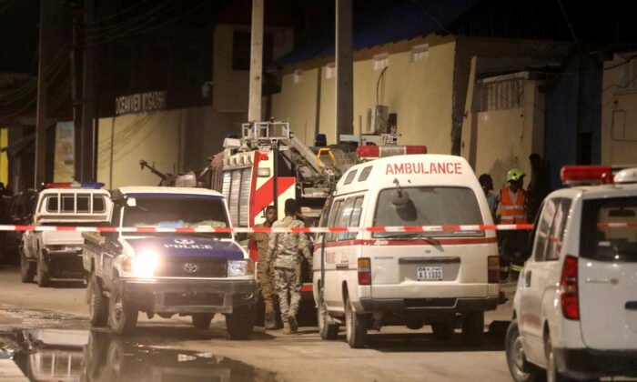 Emergency vehicles are seen at a cordoned off area near the site of a blast at the Elite Hotel in Lido beach in Mogadishu, Somalia, on Aug. 16, 2020. (Reuters/Feisal Omar)