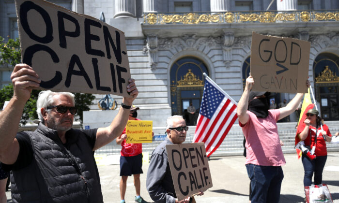 Demonstrators protest California Gov. Gavin Newsom's continued statewide shelter in place order outside of San Francisco City Hall on May 1, 2020. (Justin Sullivan/Getty Images)