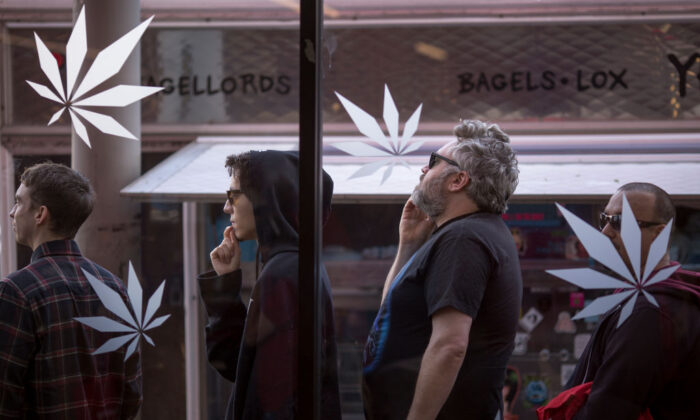People stand in line outside of MedMen, which sells marijuana for recreational use, in West Hollywood, Calif., on Jan. 2, 2018. (David McNew/Getty Images)