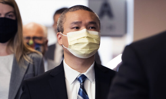 Former Minneapolis police officer Tou Thao is flanked by his attorneys as he arrives at the Hennepin County Courthouse before a motions hearing in Minneapolis, Minn., on July 21, 2020. (Evan Frost/Minnesota Public Radio via AP, File)