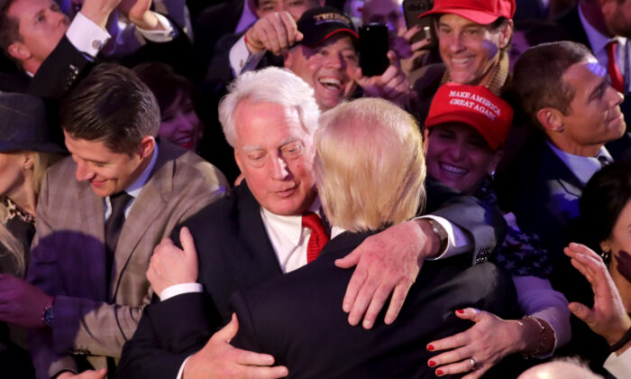 Then-president-elect Donald Trump (R) hugs his brother Robert Trump after delivering his acceptance speech at the New York Hilton Midtown in New York City in the early morning hours of Nov. 9, 2016. (Chip Somodevilla/Getty Images)