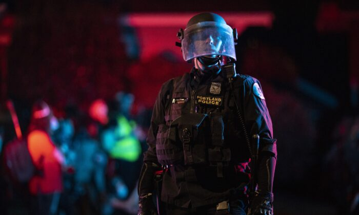 Portland police are seen in riot gear in Portland, Ore., on Aug. 15, 2020. (Paula Bronstein/Getty Images)