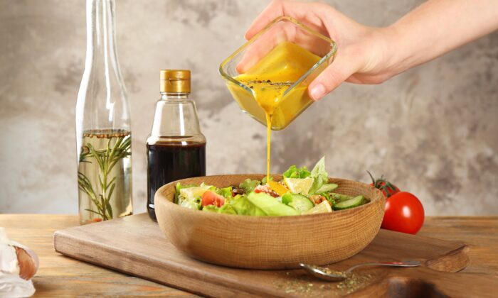 Homemade salad dressing is easy to make and vastly healthier than most store-bought varieties. (Africa Studio/Shutterstock)